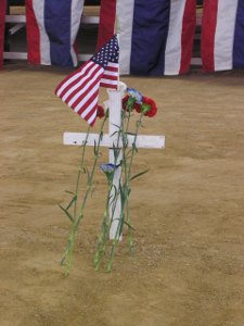 Cross with flag and flowers